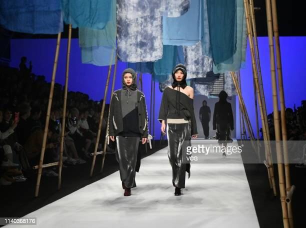 Models showcase designs on the runway during the Ji Cheng Collection show on day 8 of Shanghai Fashion Week 2019 A/W at the Shanghai Xintiandi Hall A...