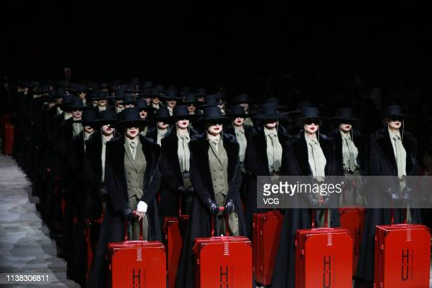 Models showcase designs on the runway during the Sheguang Hu Collection show on day one of China Fashion Week A/W 2019/2020 at the 751D Park on March...