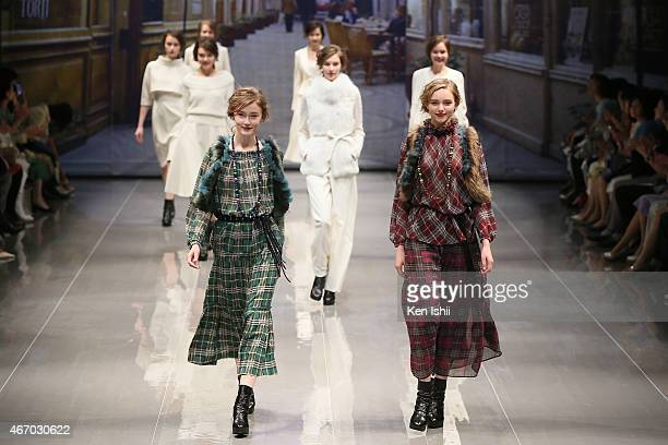 Models showcase designs on the runway during the YUKI TORII show as part of Mercedes Benz Fashion Week TOKYO 2015 A/W at EBiS on March 20 2015 in...