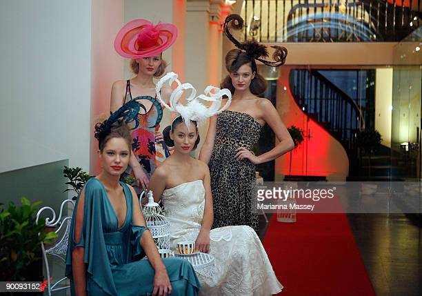 Models showcase dresses designed by Leona Edmiston Akira Manning Cartell and Lisa Ho with headpieces by Paris Kyne Master Milliner at the launch of...