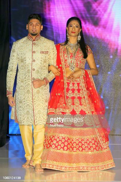 Models showcase elegant bridal outfits from India during an Indian bridal fashion show held in Scarborough Ontario Canada