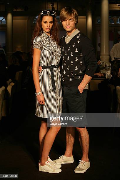 Models showcase outfits on the catwalk from designer Tommy Hilfiger's new collection at the Tommy Hilfiger Spring/Summer Launch at Est Restaurant on...