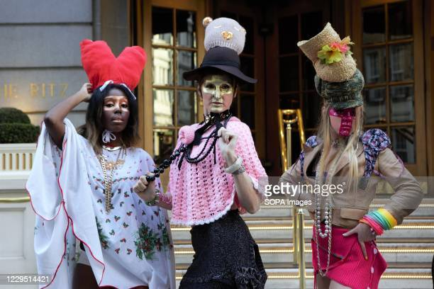Models showcase Pierre Garroudi collection during the flash mob fashion show in Central London.