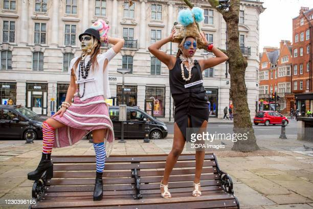 Models showcase Pierre Garroudi's latest collection during the designer's flash mob fashion show New Year Special at Sloane Square in London.