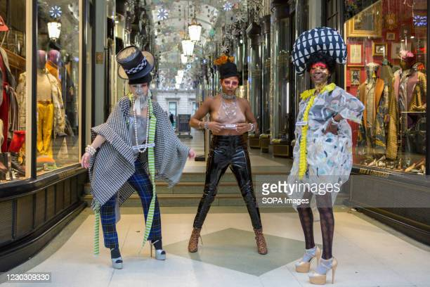 Models showcase Pierre Garroudi's latest collection on Boxing day at one of the designer's specialty flash mob fashion show in central London.
