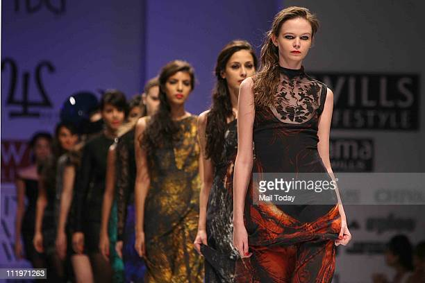Models showcase the collection 'Walnut' by designers Nidhi and Divya Gambhir during the Wills Lifestyle India Fashion Week Fall/Winter 2011 in New...