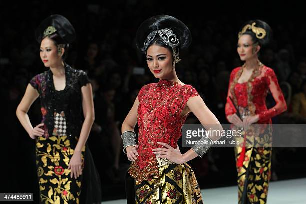 Models showcases designs by Anne Avantie on the runway during Indonesia Fashion Week 2014 day 4 at Jakarta Convention Center on February 23 2014 in...
