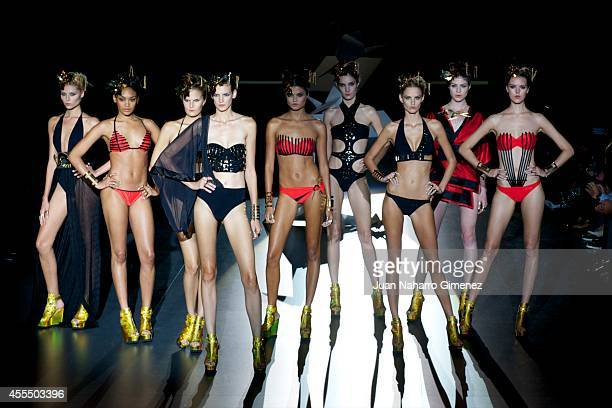 Models showcases designs by Dolores Cortes on the runway at the Dolores Cortes show during Mercedes Benz Fashion Week Madrid Spring/Summer 2015 at...
