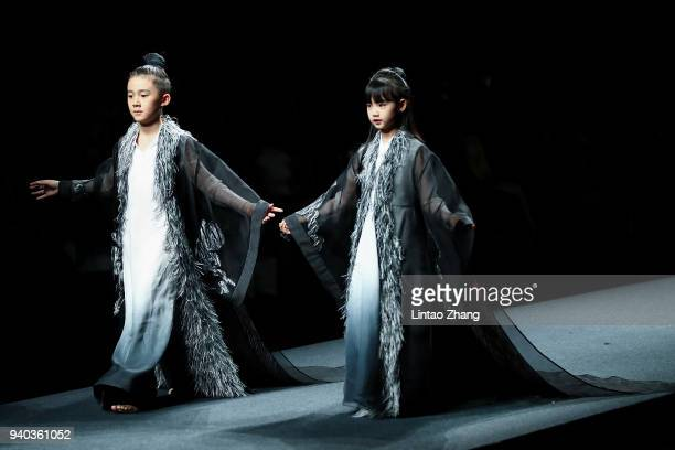 Models showcases designs on runway at the Heaven Gaia show by designer Xiong Ying during the MercedesBenz China Fashion Week A/W 2018/2019 at Beijing...