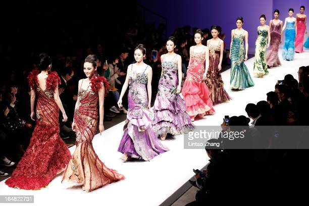 Models showcases designs on the catwalk during LU Classic Lu Weixing Dress Collection on the fifth day of Mercedes-Benz China Fashion Week...