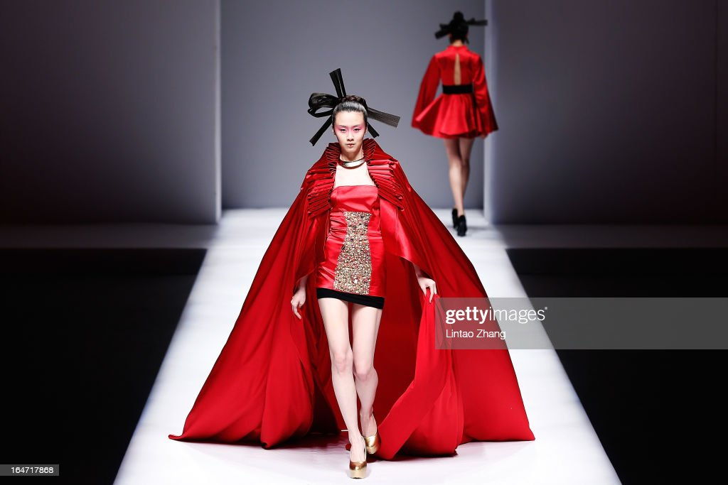 Models showcases designs on the catwalk during Minzu University of China Collection on the four th day of Mercedes-Benz China Fashion Week Autumn/Winter 2013/2014 at Banquet Hall of Beijing Hotel on March 27, 2013 in Beijing, China.