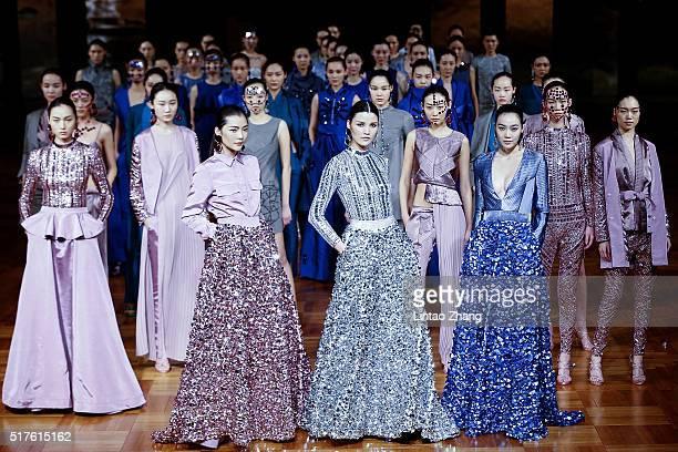 Models showcases designs on the runway at Asahi Kasei Chinese Fashion Designer Creativity AwardLiu Sicong Collection show during the MercedesBenz...