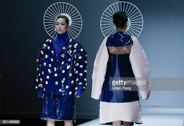 Models showcases designs on the runway at China Academy of Art School of Design Graduate Show during the day one of China Graduate Fashion Week at...