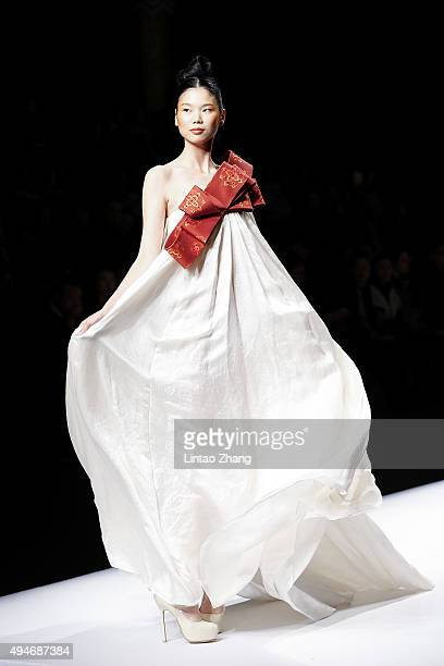 Models showcases designs on the runway at Chuhetingxiang Chu Yan Collection show during the MercedesBenz China Fashion Week Spring/Summer 2016 at...