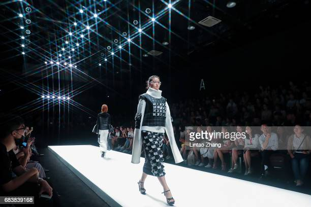 Models showcases designs on the runway at College of Fine Arts and Design of Tianjin Normal University Show during the day two of China Graduate...