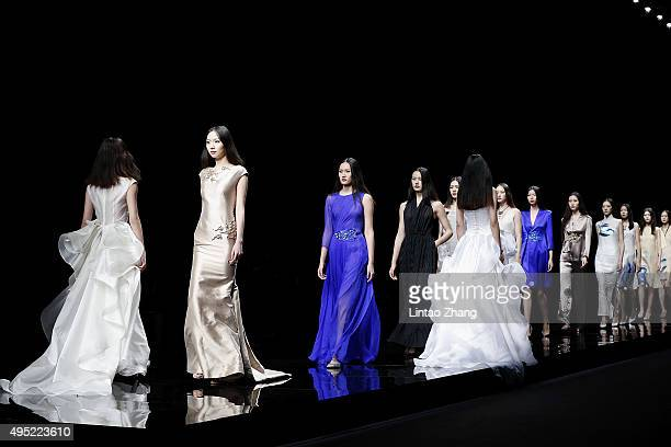 Models showcases designs on the runway at Fei Gallery Boutique Sun Xuefei Collection show during the MercedesBenz China Fashion Week Spring/Summer...