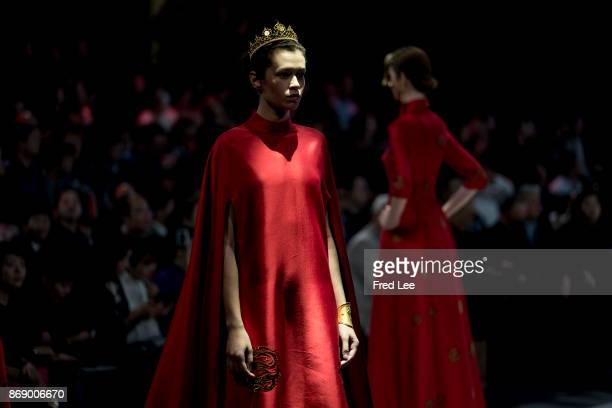 Models showcases designs on the runway at the EVE CINA Collection show during the MercedesBenz China Fashion Week Spring/Summer 2018 Collection at...