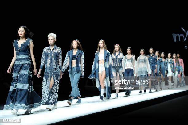 Models showcases designs on the runway at the MX Collection show by designer Yang Shan during the MercedesBenz China Fashion Week Spring/Summer 2018...