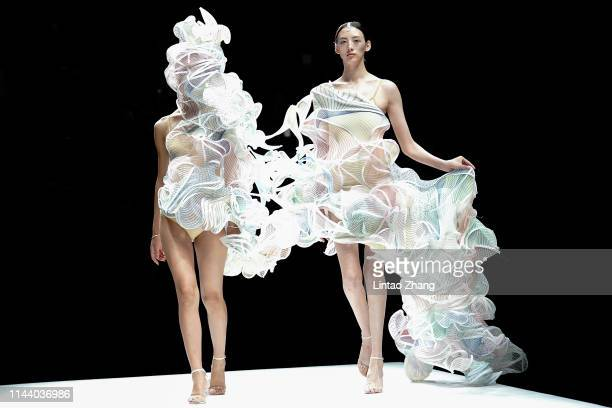 Models showcases designs on the runway at the 'School of Innovation Design, Guangzhou Academy of Fine Arts' show on day four of China International...