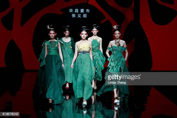 Models showcases designs on the runway during the Creative Rongchang Grass Cloth by Yichao Zhang show during MercedesBenz China Fashion Week...