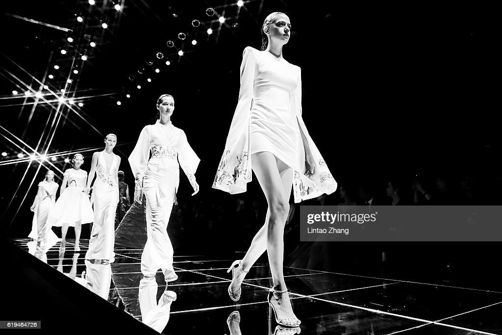 Models showcases designs on the runway during the Dennis wedding dress conference show during Mercedes-Benz China Fashion Week Spring/Summer 2017 at 751D park on October 31, 2016 in Beijing, China. China. The fashion week runs from 25 October to 02 November.