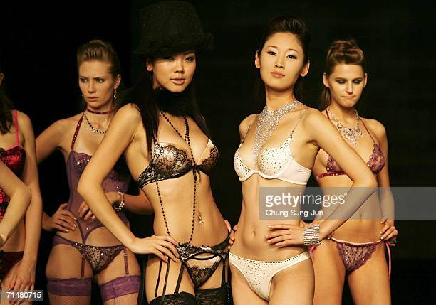 Models showing lingerie from 'Try Brands' on the catwalk during the '2006 Seoul Bodywear Show' held at the Hyatt hotel on July 19 2006 in Seoul South...