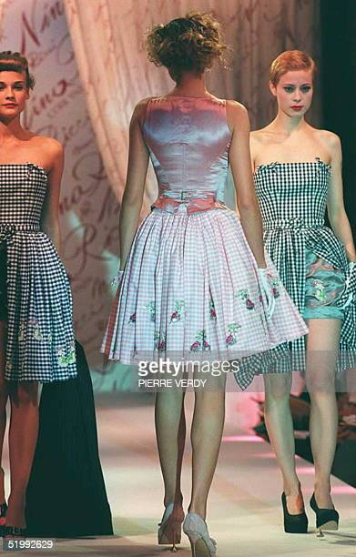 Models shows Nina Ricci gingham satin shorts and tops in the SpringSummer 1996 readytowear collection in Paris 13 October