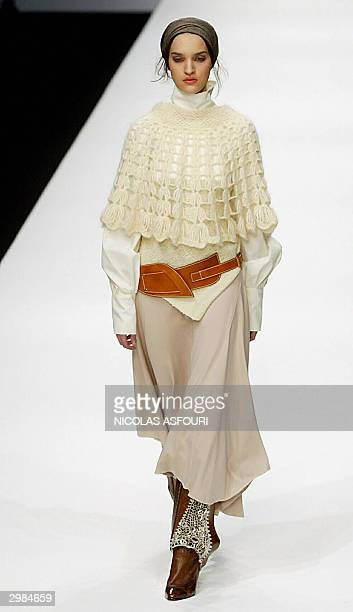 Models shows outfits by designer Bora Aksu during autumn/winter 2004-2005 presentations at the London Fashion Week in London 15 February 2004. AFP...
