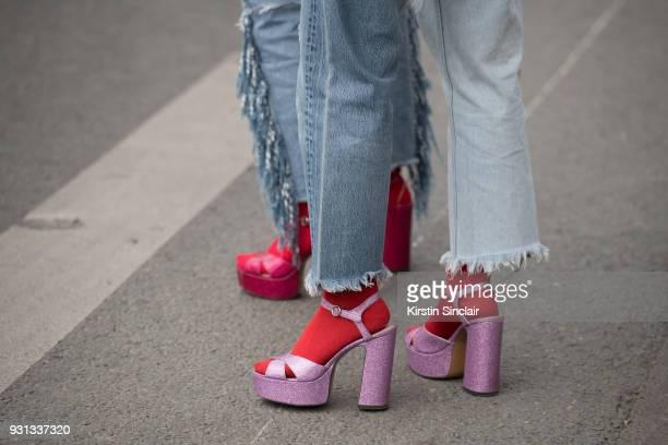 Models Singers and DJ's Aya Suzuki and Ami Suzuki of pop duo Amiaya wear Levi Strauss jeans day 2 of Paris Womens Fashion Week Spring/Summer 2018 on...