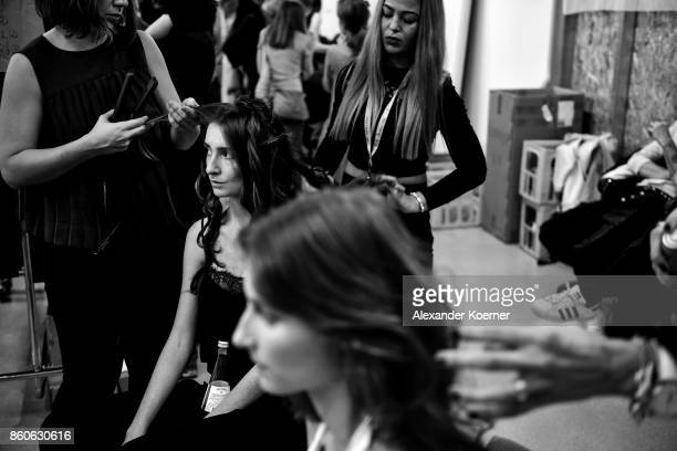 Models sit backstage prior walking the runway at the American Women's Club And Esmod Charity Fashion Show at DRIVE Volkswagen Group Forum on October...