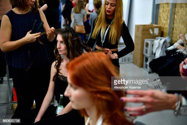 Models sit backstage prior walking the runway during the American Women's Club And Esmod Charity Fashion Show at DRIVE Volkswagen Group Forum on...