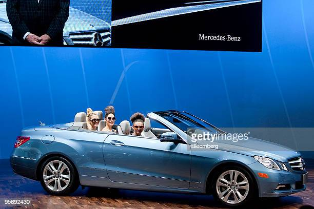 Models sit inside Daimler AG's MercedesBenz E350 convertible after it was unveiled on day one of the 2010 North American International Auto Show in...