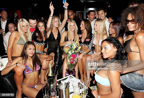 Models sit together for a photo after participating in the Gridmodels 2006 Calendar Catwalk Competition at The Penthouse on August 24 2005 in London...