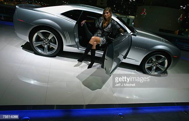 Models sits inside a Chevrolet Camaro at the 77th International Motor Show March 7 2007 in Geneva Switzerland The first major car show in Europe is...