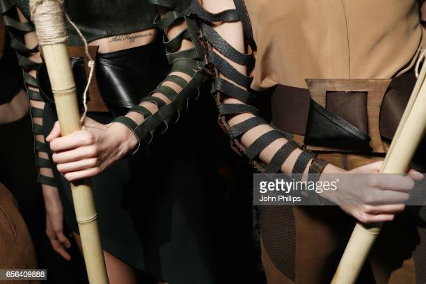 Models sleeve details are seen backstage ahead of the Ceren Ocak show during MercedesBenz Istanbul Fashion Week March 2017 at Grand Pera on March 22...