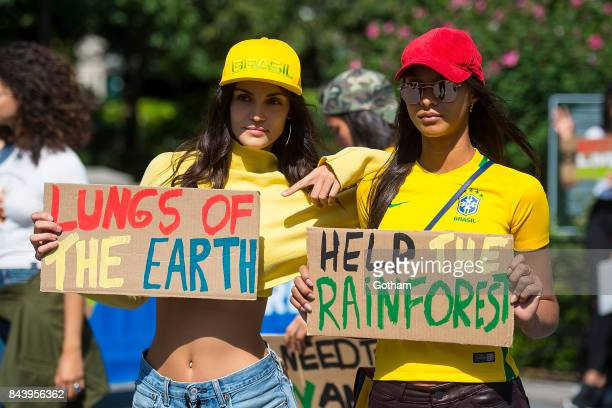 Models Sofia Resing and Lais Ribeiro are seen during a protest to save the Amazon rainforest in Union Square on September 7 2017 in New York City