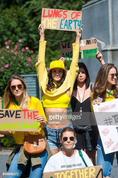 Models Sofia Resing is seen during a protest to save the Amazon rainforest in Union Square on September 7 2017 in New York City
