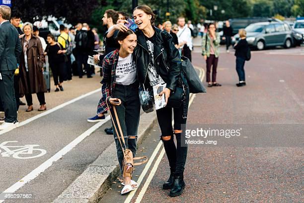 Models Sofia Tesmenitskaya and Inga Dezhina exit the Paul Smith show at the Serpentine Galleries in Kensington Gardens during London Fashion Week...