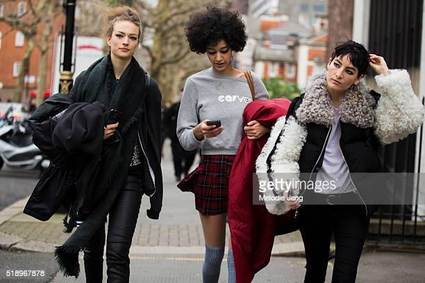 Models Sophia Ahrens Damaris Goddrie and Heather Kemesky exit the Topshop show at Tate Britain during London Fashion Week Autumn/Winter 2016/17 on...
