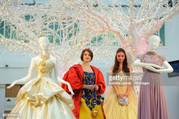 Models Sophie Porley wearing a Snow White dress by Oscar de la Renta and Naima Bossi wearing a Belle dress by Valentino part of a collection of 10...