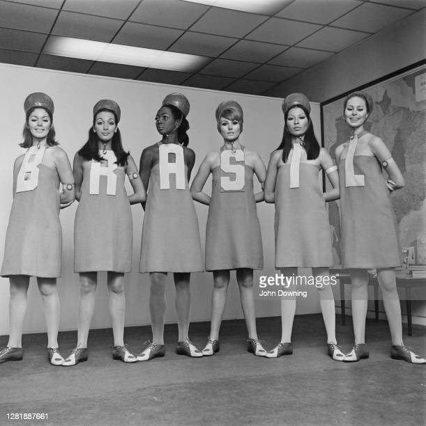 Models spelling out the word 'Brasil' at a fashion show at the Brazilian Embassy in London, UK, 23rd June 1966. The models are Mila, Cristya, Luana,...