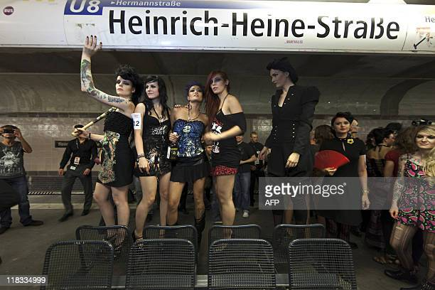 """Models stand on the platform of the Underground after they presented fashion during the """"Underground Catwalk"""" show during the Berlin Fashion Week on..."""