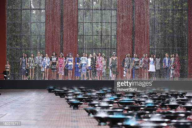 Models stand on the runway during the Kenzo show at 'Cite du Cinema' of Saint-Denis as part of the Paris Fashion Week Womenswear Spring/Summer 2014...
