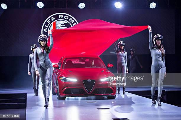 Models surround a 2017 Alfa Romeo Giulia Quadrifoglio vehicle during the North American debut at the Los Angeles Auto Show in Los Angeles California...