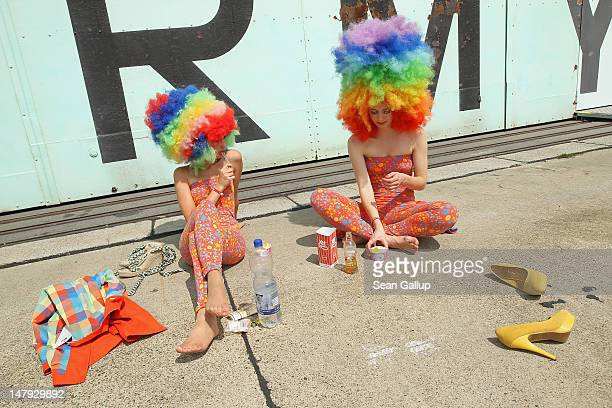 Models take a break outside a former aircraft hangar at Temepelhof Airport at the 2012 Bread & Butter fashion trade fair on July 6, 2012 in Berlin,...