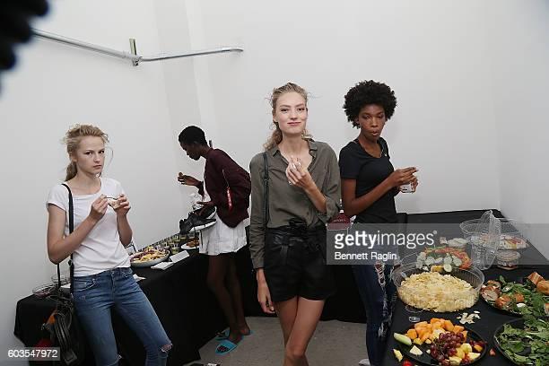 Models take a break to eat backstge during Zac Posen Backstage September 2016 New York Fashion Week at Spring Studios on September 12 2016 in New...