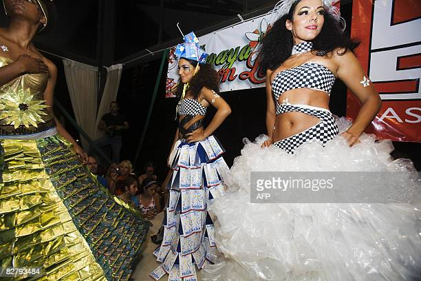 Models take a final walk at the end of the completion of the Trashion Fashion show in Tamarindo, Costa Rica, on September 11, 2008. The show was...