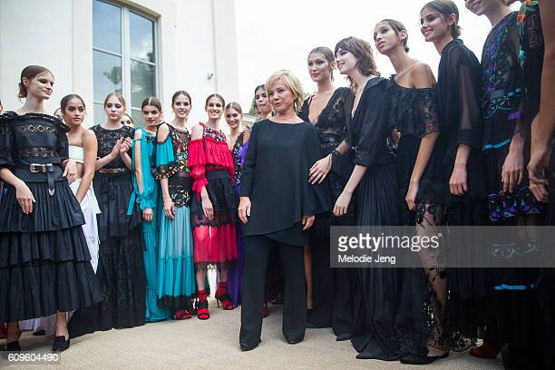 Models take a photo after the Alberta Ferretti with Alberta Ferretti during Milan Fashion Week Spring/Summer 2017 on September 21 2016 in Milan Italy