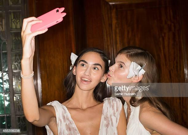 Models take a selfie photo backstage at the Zeynep Kartal show during London Fashion Week Spring Summer 2015 at Fashion Scout Venue on September 13...