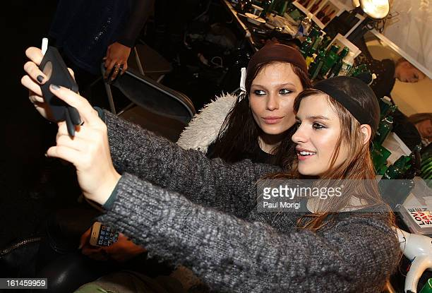 Models take a self-portrait backstage at ICB By Prabal Gurung during Fall 2013 Mercedes-Benz Fashion Week at The Studio at Lincoln Center on February...